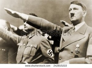 stock-photo-adolf-hitler-giving-nazi-salute-to-hitler-s-right-is-rudolph-hess-242815222